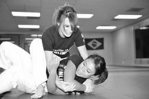 Woman training BJJ